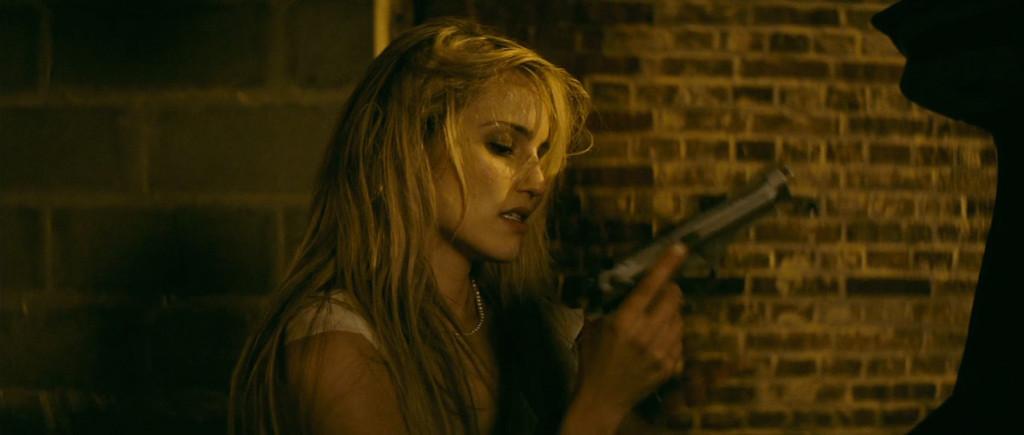 Girl with a gun? Hmm.